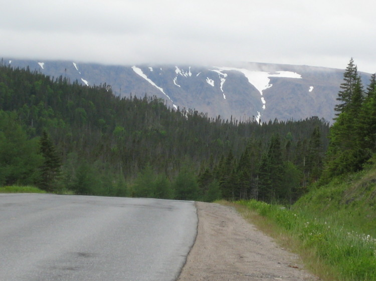 Snow on the mountains outside Rocky Harbor