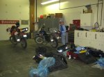 Unpacking the bikes at the shipping agent.
