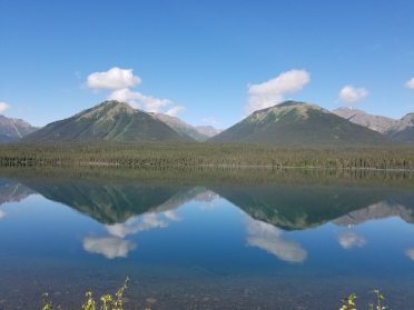 Mirror surface of a lake in Iskut, British Columbia.
